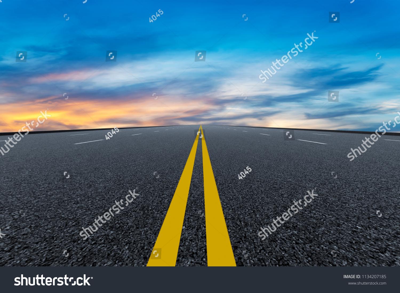 stock-photo-empty-highway-asphalt-pavement-and-beautiful-sky-cloud-1134207185